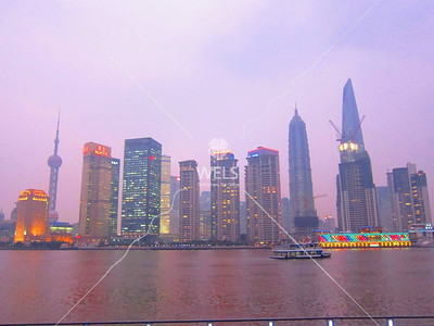 Shanghai's financial district. Showing 3 of the world's top 10 tallest buildings and the one under construction will be the world's tallest upon completion by kstellick